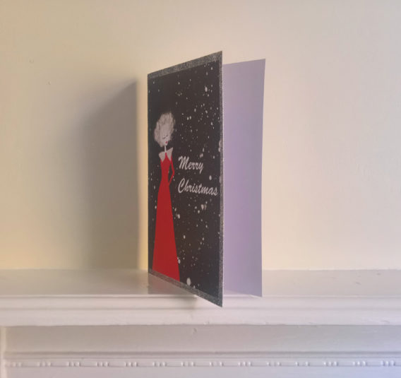 woman white hair christmas card
